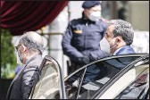 ?? FLORIAN SCHROETTER — THE ASSOCIATED PRESS ?? Political deputy at the Ministry of Foreign Affairs of Iran Abbas Araghchi, right, arrives at the Grand Hotel Wien in Vienna, Austria, on Tuesday. The hotel is the site of closed-door nuclear talks with Iran.