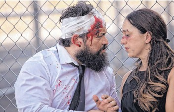 """??  ?? Ezra Colón and Amelia Ampuero star in """"Gruesome Playground Injuries"""" at Duke City Repertory."""