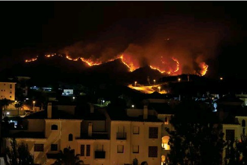 ?? (Getty) l ?? Thousands have fled the resort town of Estepona on the Costa del So