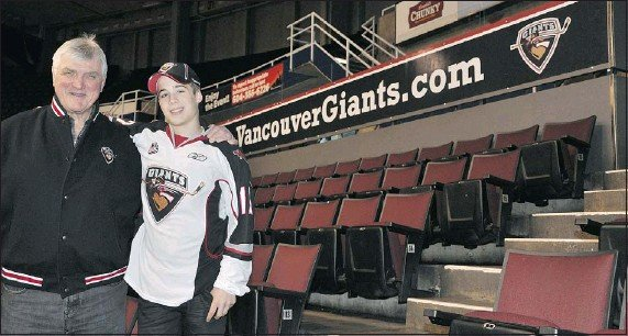 ?? — VANCOUVER GIANTS ?? Giants' draft pick Ty Ronning with hockey legend Pat Quinn, who is part of the team's ownership group.