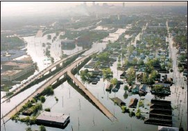 ?? ASSOCIATED PRESS FILE ?? Floodwaters from Hurricane Katrina fill the streets near downtown New Orleans in August 2005.
