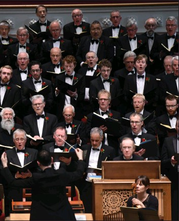 ??  ?? Andrew Nunn conducting the choir in Glasgow City Hall. Below: some members at its golden jubilee in 2018