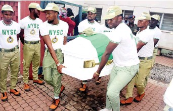 ??  ?? National Youth Service Corps (NYSC) members carrying the remains of their colleague, Mr. Precious Owolabi, who was killed during a protest by the Islamic Movement of Nigeria also known as Shiites on Monday in Abuja ...yesterday.