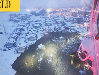 ?? NORWEGIAN RESCUE SERVICE / NTB / VIA REUTERS ?? A rescue helicopter view shows the aftermath of a landslide in a village just north of Oslo, Norway, on Wednesday.