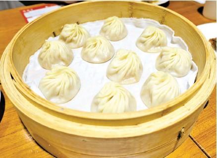 ??  ?? DREAM DUMPLINGS Clockwise from above: Din Tai Fung's famous pork xiao long bao; salted egg yolk prawns; and black truffle xiao long bao