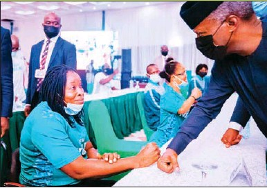 ??  ?? •Vice President Yemi Osinbajo (right) having fist bump with one Nigeria's Olympic-bound athletes at the display of their kits and send off in Abuja ... yesterday
