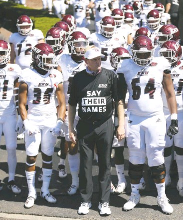 """?? EASTERN KENTUCKY UNIVERSITY ATHLETICS ?? Eastern Kentucky's Walt Wells wore a shirt that reads """"Say their names"""" as he led his team onto the field last year."""