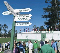 ?? DON EMMERT/GETTY IMAGES ?? Patrons arrive to watch Monday's practice round of the 80th Masters Tournament.