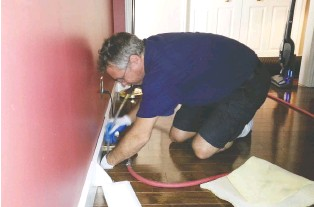 """??  ?? Having your home's air ducts cleaned professionally is the best option, since technicians like this have the proper equipment — adapters and brushes like the so-called whipper that spins and turns inside the duct """"to wake up the sleeping dirt"""" which is sent directly to the vacuum."""