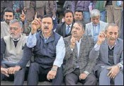 ?? PTI ?? National Conference members of legislative council (MLCs) during a protest at the assembly complex in Jammu on Tuesday.