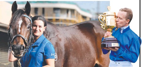 ??  ?? Doomben 10,000 contender Trekking with stablehand Lizzy Grima at Eagle Farm and (inset) Kerrin McEvoy kisses the Stradbroke Handicap trophy after Trekking's win in 2019. Main picture: Liam Kidston