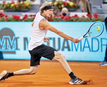 ?? AP PHOTO ?? Germany's Alexander Zverev returns the ball to Italy's Matteo Berrettini during the men's final match at the Mutua Madrid Open tennis tournament in Madrid, Spain, Sunday, May 9, 2021.