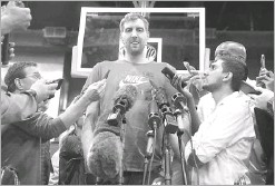 ?? Tom Fox/staff Photographer ?? Dirk Nowitzki visits with the media after the Mavericks conducted seasonending exit interviews.