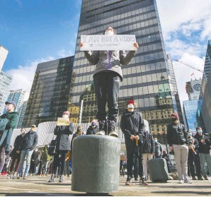 ?? ARLEN REDEKOP ?? Sherry Tian, 16, holds a sign at a March anti-Asian hate rally at the Vancouver Art Gallery, held in response to the escalating hate crimes across North America. There are several things governments and individuals can do to combat racism.
