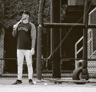 ?? Karen Warren / Staff photographer ?? Slated to join a loaded crop of free-agent shortstops next winter, Carlos Correa, waiting for the batting cage Monday in West Palm Beach, Fla., says he would even play third base if needed.