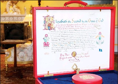 ??  ?? The 'Instrument of Consent', which is the Queen's historic formal consent to Prince Harry's forthcoming marriage to Meghan Markle, photographed at Buckingham Palace in London on May 11. (AP)