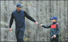 ?? AP ?? Tiger Woods enjoys a round of golf with his son Charlie at a tournament in Orlando, Florida, on Dec 17 last year.