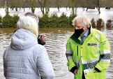 ??  ?? Hell and high water...flood victims tell Boris about their distress in Didsbury