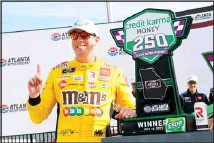 ??  ?? Kyle Busch celebrates in Victory Lane after wining a NASCAR Xfinity Series auto race, on July 10, in Hampton, Ga. (AP)