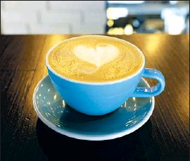 ?? Myung J. Chun Los Angeles Times ?? COFFEE FUTURES recently jumped to the highest level in four years partly because of extreme weather in Brazil, the world's largest coffee producer.
