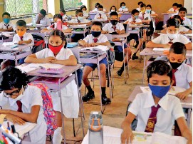 ??  ?? School in Minuwangoda: Following primary precautions such as wearing masks and keeping social distance. Pix by Priyanthe Wickramaarachchi