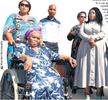 ??  ?? Cllr Peggy Nkonyeni (MEC for Human Settlement and Public Works) with resident Bukwaphi Mhlongo in the wheelchair, Mphile Mngadi (Ward 9 councillor), Dolly Shandu (iLembe District Deputy Mayor) and Cllr Phindile Sishi (Mandeni Local Municipality Acting Mayor)