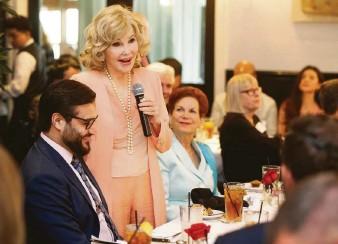 ?? Melissa Phillip / Houston Chronicle ?? Houston socialite Joanne King Herring, center, joins Afghanistan's ambassador to the United States, Hamdullah Mohib, left, during an award luncheon at Ouisie's Table in River Oaks on Friday.