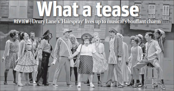 """??  ?? Tracy Turnblad (Lillian Castillo, center) rallies her friends and neighbors during a production number in """"Hairspray"""" at Drury Lane Oakbrook Theatre."""