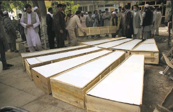 ?? Mehrab Ibrahimi / Associated Press ?? Coffins of the 10 victims are placed side by side at a hospital in Baghlan province, Afghanistan. The staff members of the nonprofit HALO Trust were attacked by Islamic State gunmen.