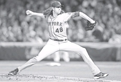 ?? JERRY LAI, USA TODAY SPORTS ?? Mets starting pitcher Jacob deGrom shut down the Cubs in Game 3, allowing two runs on four hits in seven innings.