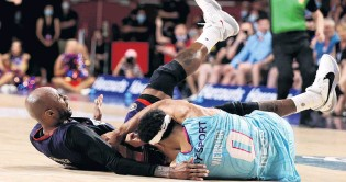 ?? PHOTO: GETTY IMAGES ?? Tony Crocker, of the Adelaide 36ers (left) and Tai Webster, of the Breakers, end up on the floor during the round two NBL match in Adelaide on Friday.
