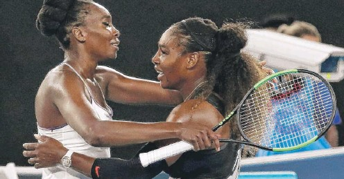 ??   KIN CHEUNG/ AP ?? Serena Williams ( right) embraces sister Venus after beating her 6- 4, 6- 4 in the Australian Open final Saturday morning.