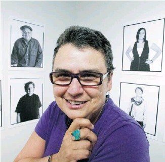 ?? PAT MCGRATH/OTTAWA CITIZEN ?? Rosalie Favell, the winner of city's Karsh Award for photography, with some of her portraits.