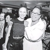 ?? RICH POLK, GETTY IMAGES, FOR ESSENCE ?? Thandie Newton and Oprah Winfrey give some extra star wattage to Essence's Black Women in Hollywood luncheon Thursday.
