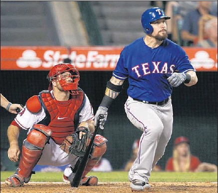 ?? Alex Gallardo Associated Press ?? A FIFTH-INNING DOUBLE may have helped ease any tension Josh Hamilton might have felt. He had two hits and scored twice.