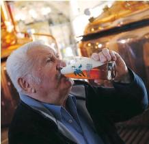 ??  ?? Customer Franz Brugger enjoys a fresh brewed beer in the brewery Griessbraeu in Murnau, Germany on Thursday.