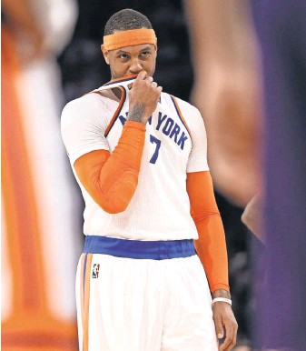 "?? BRAD PENNER, USA TO­DAY SPORTS ?? Knicks for­ward Carmelo An­thony, who has a no- trade clause, has been men­tioned in many ru­mors. I try not to think about it,"" he says. ""It's a lit­tle dif­fi­cult not to think about it."""