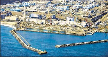 ?? REUTERS ?? An aerial view shows storage tanks for treated water at the tsunami-hit Fukushima Daiichi nuclear power plant in Okuma town, Fukushima, Japan.