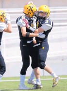 ?? MARLA BROSE/JOURNAL ?? St. Pius' Ryan McGaha, right, celebrates a touchdown with teammate Jacob McCoy. The two receivers accounted for five touchdowns in a win over Alamogordo.