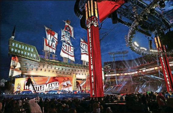?? Photos by LUIS SANTANA   Times ?? Everything seems larger than life when it comes to the WWE. WrestleMania 37 at Raymond James Stadium, home of the latest Super Bowl champs, is no exception.