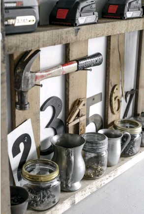 """??  ?? NUMBERS AND SCREWS interplay with Donna's organizational system and also illustrate an expert tip for anyone trying to use reclaimed items for décor: you may already have what you need in your collections. """"I needed a place to store screws,"""" she says. """"So I gathered up every little container and house number I had and just played around until it became this."""""""
