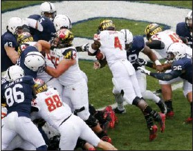 ?? GENE J. PUSKAR — THE ASSOCIATED PRESS ?? Maryland running back Wes Brown dives in for a touchdown during the second half against Penn State on Saturday.