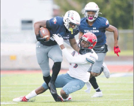 ?? CHRISTOPHER DOLAN / STAFF PHOTOGRAPHER ?? Lackawanna's Marques Deshields, left, breaks a tackle against Georgia Military College's Markell Anderson in Sunday's game.