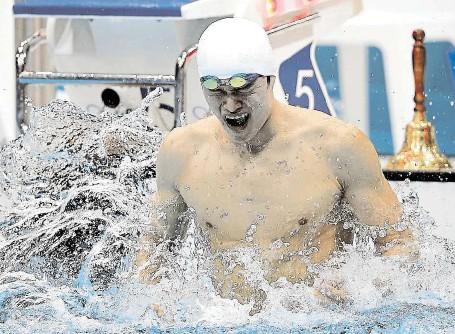 ?? Bylo v minulosti pošpiněno řadou skandálů. S dopingem se zapletl i trojnásobný olympijský vítěz a rekordman Sun Jang (na snímku). FOTO GETTY IMAGES ?? Čínské plavání