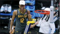 ?? DARRON CUMMINGS — THE ASSOCIATED PRESS ?? Baylor's Jared Butler cuts down the net on Monday night in Indianapolis after the Bears had beaten No. 1 Gonzaga, 86-70 for the title.