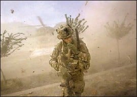 ?? David Goldman Associated Press ?? ARMY 2ND LT. Andrew Ferrara of Torrance turns away from a landing Blackhawk helicopter during a 2011 mission in Kunar province in Afghanistan.