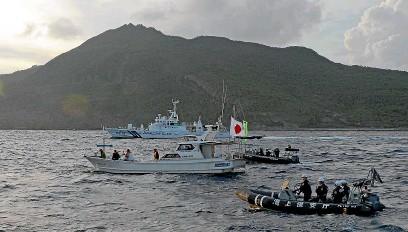 ?? AP, GETTY ?? Japanese Coast Guard boats at the Japanese-claimed Senkaku Islands. Under Xi Jinping, below, China has been ramping up its presence around the islands, which it claims as the Diaoyu Islands.