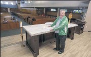 ?? HANS GUTKNECHT — STAFF PHOTOGRAPHER ?? The Rev. Norm Supancheck, the priest in residence at St. Didacus Catholic Church in Sylmar, stands by the altar he obtained from St. Barnabas Catholic Church in Long Beach.