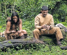 ?? Picture: National Geographic Studios. Alon Skuy ?? Bill Schindler and co-star Cat Bigney sharpen their spears before a hunt in an Ethiopian game park during an episode of 'The Great Human Race' on the National Geographic Channel. Right, Bill's necklace made from an assortment of items collected from...