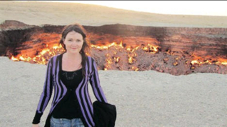 ??  ?? Dr. Fjola Helgadottir stands bravely in front of a gas crater in the middle of the Karakum desert in Turkmenistan in Central Asia.